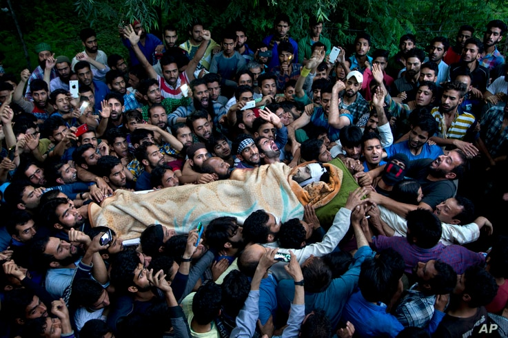 Kashmiri villagers carry body of Burhan Wani, chief of operations of Indian Kashmir's largest rebel group Hizbul Mujahideen, during his funeral procession in Tral, some 38 Kilometers (24 miles) south of Srinagar, Indian controlled Kashmir, July 9, 20...
