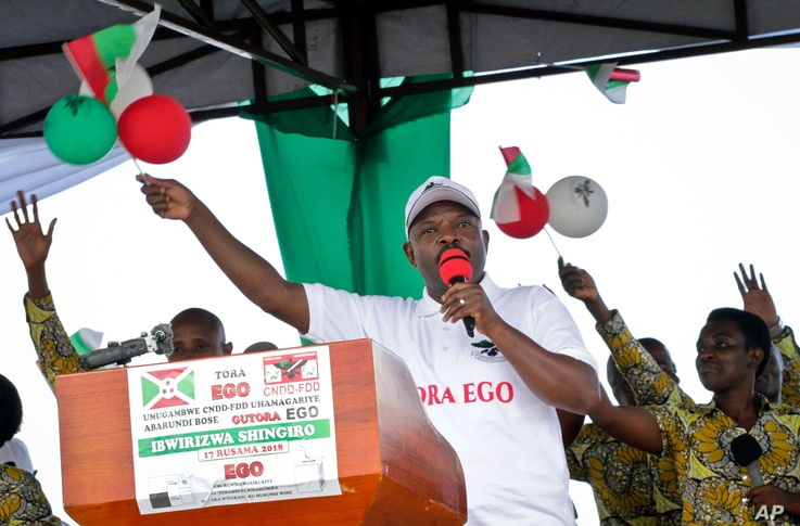 """FILE - President Pierre Nkurunziza gestures as he launches the ruling party's campaign calling for a """"Yes"""" vote in the upcoming constitutional referendum, in Bugendana, Gitega province, Burundi, May 2, 2018."""