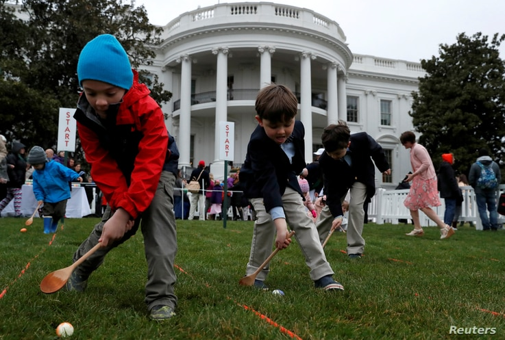 Skye Kennedy (C), 5, Seamus Menefee (L), 7, and Jack Kennedy, 8, participate in the egg roll during the annual White House Easter Egg Roll on the South Lawn of the White House in Washington, April 2, 2018.