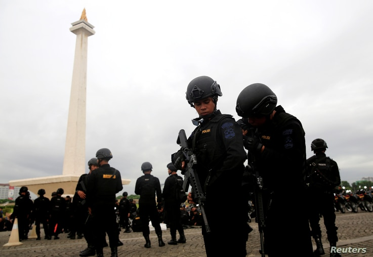 Mobile brigade policemen attend a ceremony ahead of the Christmas and New Year celebrations in Jakarta, Indonesia, Dec. 21, 2017.