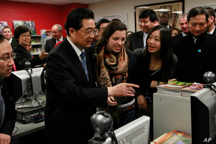 FILE - Chinese President Hu Jintao visits the The Confucius Institute which is housed at Walter Payton College Preparatory High School in Chicago, Friday, Jan. 21, 2011.