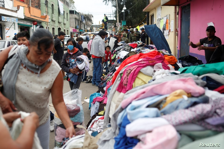 Residents look for donated clothes at a collection center after the earthquake in Xochimilco, on the outskirts of Mexico City, Mexico, Sept. 25, 2017.