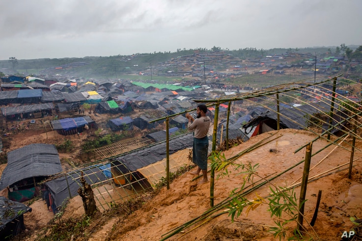 FILE - A Rohingya Muslim man, who crossed over from Myanmar into Bangladesh, builds a shelter for his family in Taiy Khali refugee camp, Bangladesh, Sept. 20, 2017. More than 500,000 Rohingyas poured across the border in late August to escape attacks...