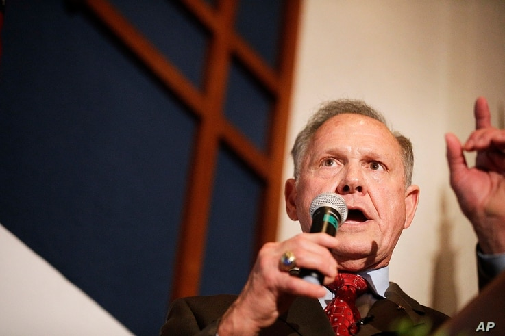 FILE - In this Aug. 15, 2017 file photo, former Alabama Chief Justice and U.S. Senate candidate Roy Moore speaks to supporters in Montgomery, Alabama.