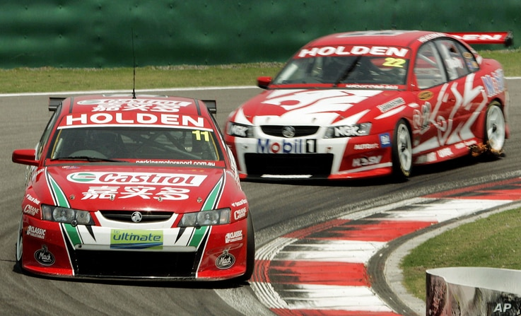 New Zealand's Steven Richards, 11, and Australian Todd Kelly, 22, during the Race 2 of V8 Supercars Shanghai Round, June 12, 2005 at Shanghai International Circuit in Shanghai, China. Mark Skaife of Holden racing Team finished the first place, Richa...