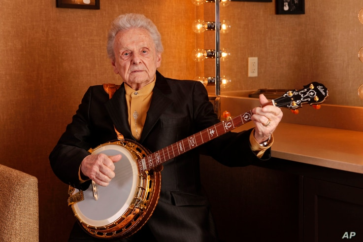 FILE - Ralph Stanley poses for a photo backstage at the Grand Ole Opry House in Nashville, Tennessee, March 11, 2011.