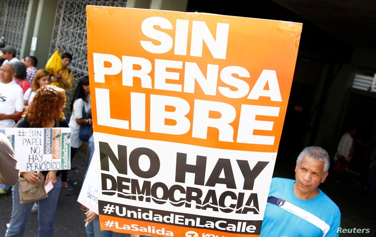 """A sign reading """"Without free press, there is no democracy"""", during a protest by newspaper workers and opposition parties in Caracas, Feb. 11, 2014."""