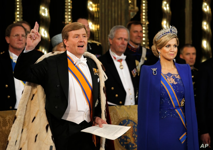 Dutch King Willem-Alexander takes the oath as Queen Maxima stands at his side at his investiture inside the Nieuwe Kerk or New Church in Amsterdam, the Netherlands, Apr. 30, 2013.