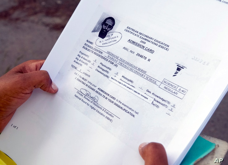 In this picture taken June 9, 2106, Hiweet Berhe Tesfamarian Kidane holds photocopies of documents she told the Associated Press belong to her brother, Medhane Tesfamariam Berhe, during an interview in Oslo. Hiweet Berhe Tesfamarian Kidane said that ...