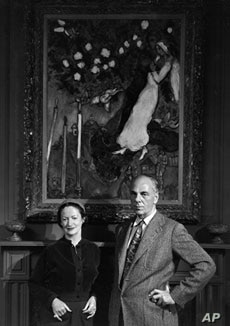 Founders Wally and Lila Wallace in front of modernist painter Marc Chagall's 'Three Candles,' one of many original pieces of art that graced the hallways at Reader's Digest headquarters.