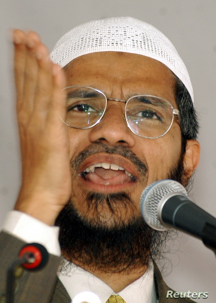 FILE - Islamic scholar Zakir Naik delivers a speech in Srinagar, in  the Indian state of Jammu and Kashmir, Sept. 7, 2003.