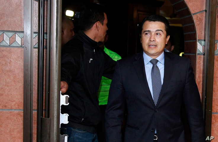 n this March 16, 2017 photo, Antonio Hernandez, brother of the current Honduran president, arrives to hold a press conference in Tegucigalpa, Honduras. A leader of a drug trafficking organization alleges that Hernandez asked him for a bribe.