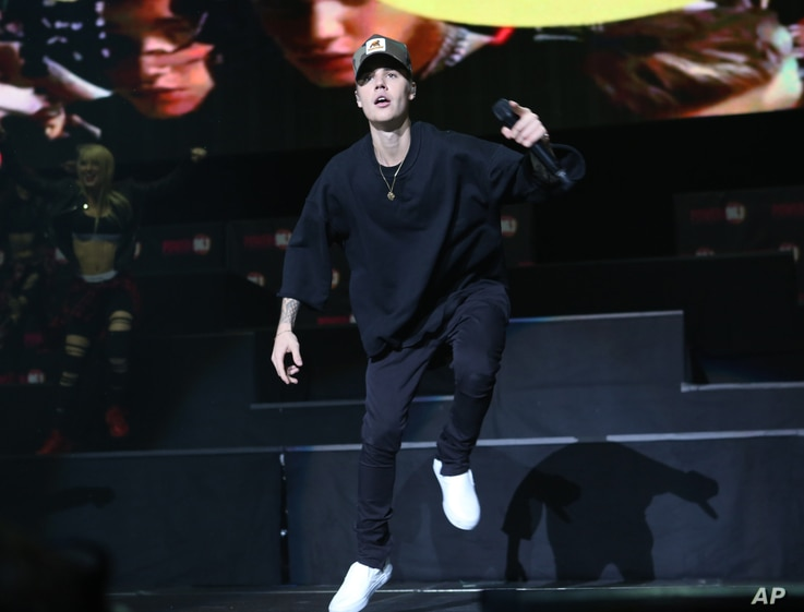 FILE - Justin Bieber performs during the Power 96.1 Jingle Ball at Philips Arena in Atlanta.