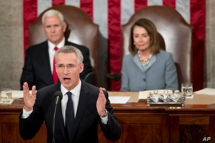 NATO Secretary General Jens Stoltenberg, accompanied by Vice President Mike Pence, left and House Speaker Nancy Pelosi of Calif., right, addresses Congress on Capitol Hill in Washington, April 3, 2019,