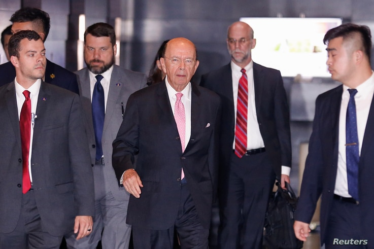U.S. Commerce Secretary Wilbur Ross leaves a hotel ahead of trade talks with Chinese officials in Beijing, June 2, 2018.
