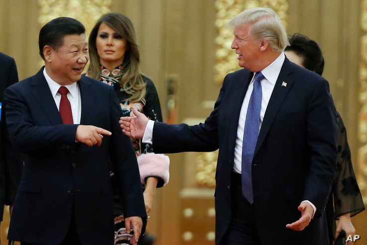 U.S. President Donald Trump China's President Xi Jinping arrive for the state dinner with the first ladies at the Great Hall of the People in Beijing, China, Nov. 9, 2017.