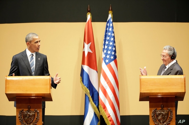 U.S. President Barack Obama, left, speaks next to Cuba's President Raul Castro, during a joint statement in Havana, Cuba, March 21, 2016.