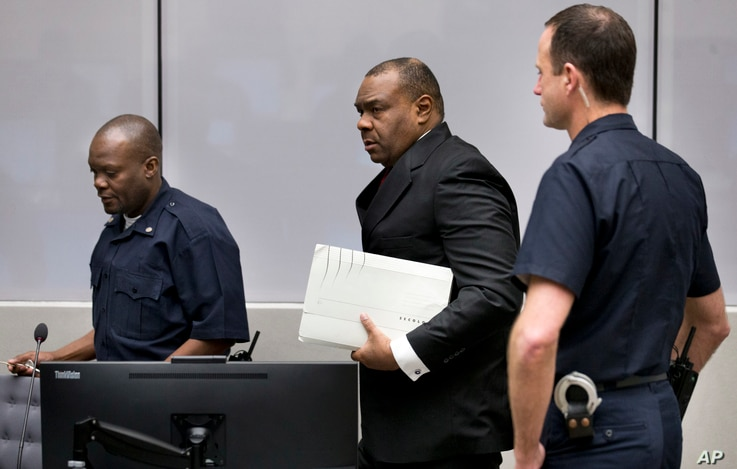 Jean-Pierre Bemba enters the courtroom of the International Criminal Court in The Hague, Netherlands, March 21, 2016. The court's judges handed him a guilty verdict.