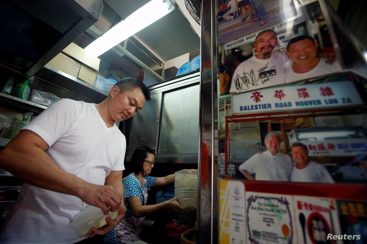 Hawker Stan Lim, 43, prepares his ingredients at Michelin Bib-Gourmand-awarded Balestier Road Hoover Rojak, at Whampoa Food Center in Singapore, Aug. 12, 2016.