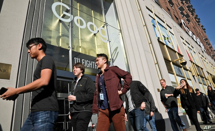 Google employees walk off the job in a protest against what they said is the tech company's mishandling of sexual misconduct allegations against executives on Nov. 1, 2018, in New York.