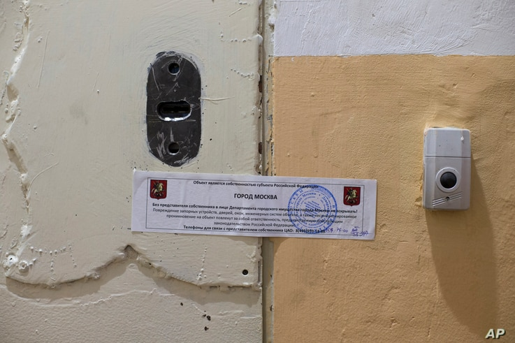The office of Amnesty International is sealed by Moscow city authorities in Moscow, Russia, Nov. 2, 2016.