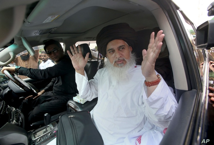 FILE - Khadim Hussain Rizvi, head of Tehreek-e-Labbaik Pakistan, a radical religious party, speaks to journalists during a rally for the upcoming general elections, in Karachi, Pakistan, July 1, 2018.