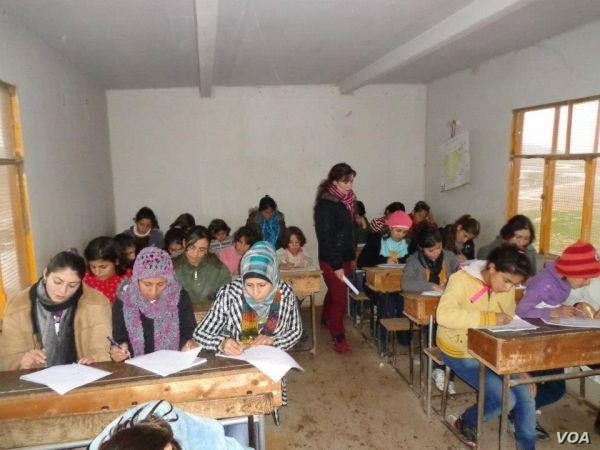 Students learn the Kurdish language at a local school in Amude, Syria, in August 2015. (Photo courtesy of Bedirxan Committee for Teaching Kurdish)