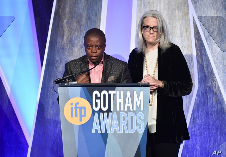 """Director Yance Ford, left, and producer Joslyn Barnes accept the best documentary award for """"Strong Island"""" at the 27th annual Independent Film Project's Gotham Awards at Cipriani Wall Street, Nov. 27, 2017, in New York."""