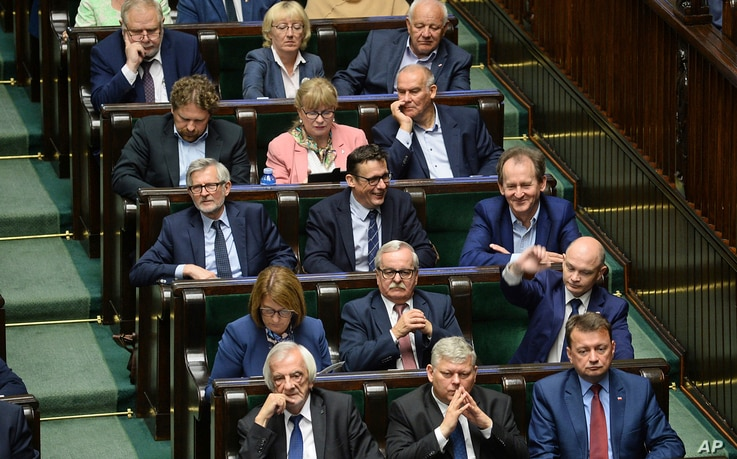 Lawmakers from the Law and Justice party listen to debate on changes to a controversial Holocaust law, in Warsaw, Poland, June 27, 2018.