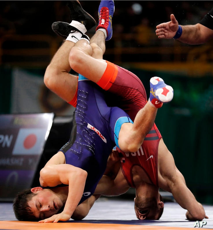 Japan's Yuki Takahashi, left, controls United States' Thomas Gilman, right, during their 57 kg match in the Freestyle Wrestling World Cup, April 7, 2018, in Iowa City, Iowa.