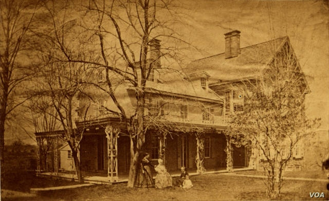 Lucretia and James Mott's home in Cheltenham, 'Roadside,' was a stop on the Underground Railroad. Lucretia Mott is in the chair in the foreground. The house was demolished in 1911.