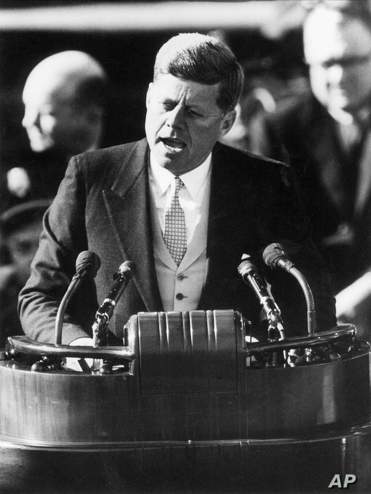 FILE - President John F. Kennedy delivers his inaugural address after taking the oath of office at the Capitol in Washington, D.C., Jan. 20, 1961.