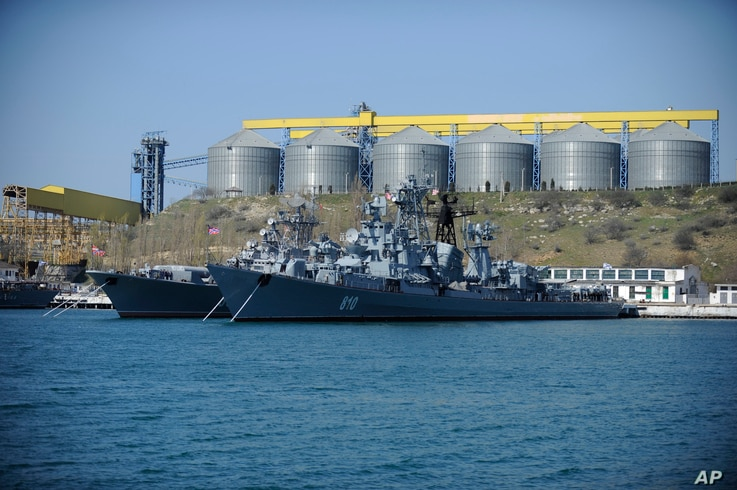FILE - A March 31, 2014  photo shows Russian Black Sea fleet ships anchored in one of the bays of Sevastopol, Crimea.