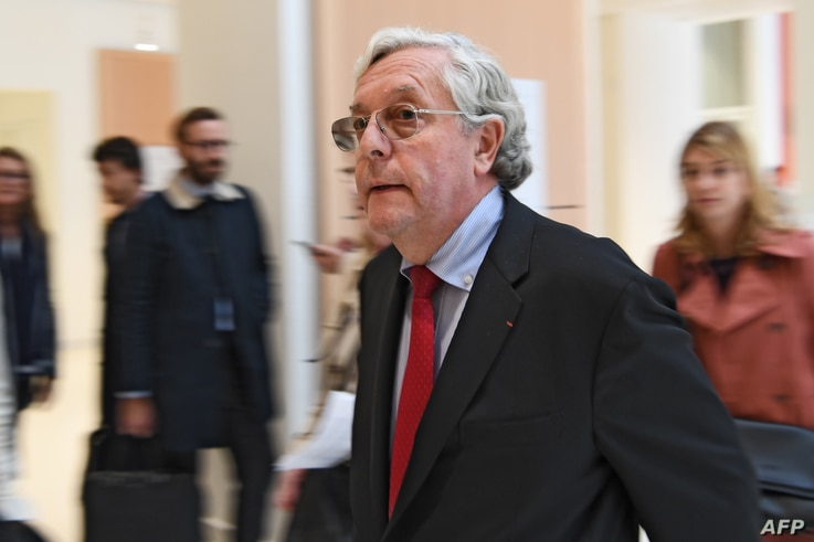 FILE - French government attorney Xavier Normand Bodard arrives at Paris' courthouse, Oct. 8, 2018 , prior to the trial of Swiss Bank UBS.