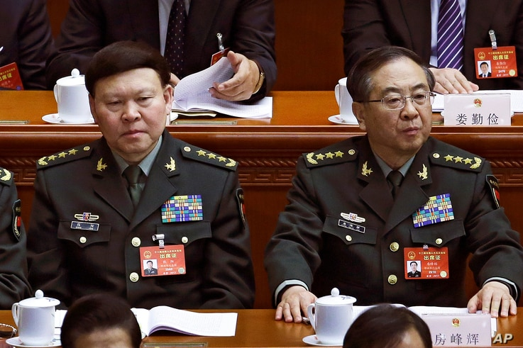 In this March 8, 2017, photo, Zhang Yang, left, the then-head of China's People's Liberation Army (PLA) political affairs department, and Fang Fenghui, right, the then-chief of the general staff of the Chinese People's Liberation Army, attend the Chi...