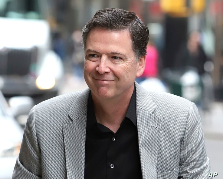 """Former FBI director James Comey arrives for an appearance on """"The Late Show with Stephen Colbert"""" at the Ed Sullivan Theater, April 17, 2018, in New York."""
