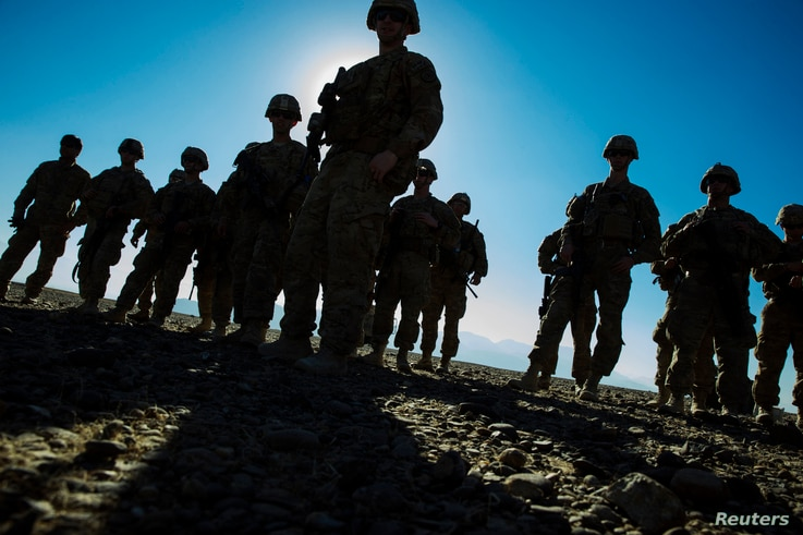 U.S. soldiers from Dragon Company of the 3rd Cavalry Regiment are silhouetted