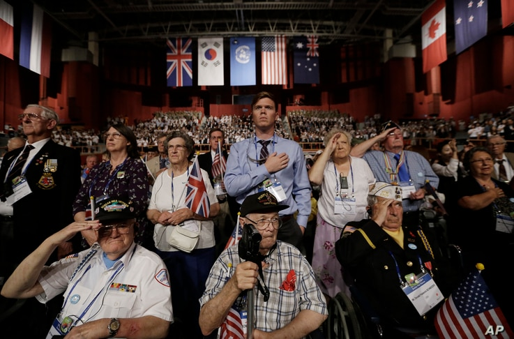 Foreign veterans of the Korean War and their family members salute during a commemorative ceremony marking the 63rd anniversary of the Armistice Agreement and UN Forces Participation in the Korean War in Seoul, South Korea on July 27, 2016.