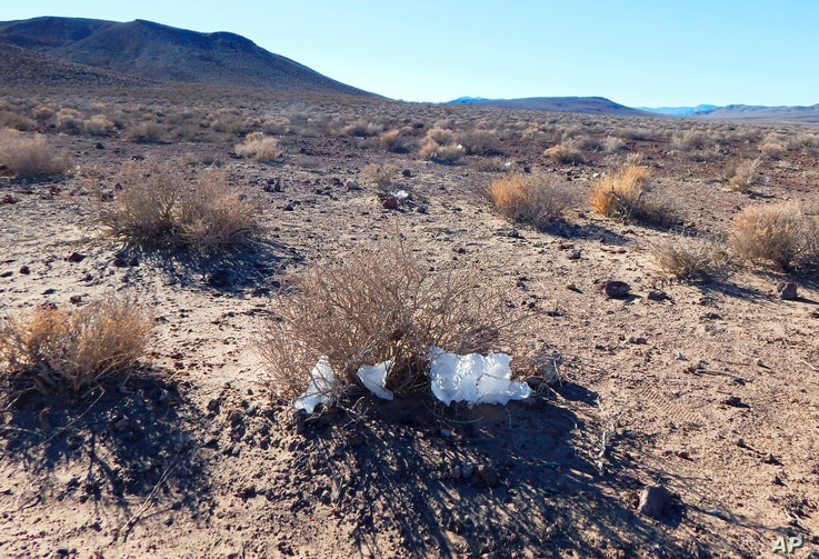 This undated photo provided by the U.S. National Park Service shows toilet paper strewn throughout Death Valley National Park, Calif. National parks across the United States are scrambling to clean up and repair damage caused by visitors and storms d...