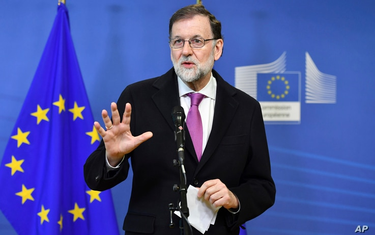 Spanish Prime Minister Mariano Rajoy speaks with the media as he arrives for an EU-Sahel meeting at EU headquarters in Brussels on Friday, Feb. 23, 2018.