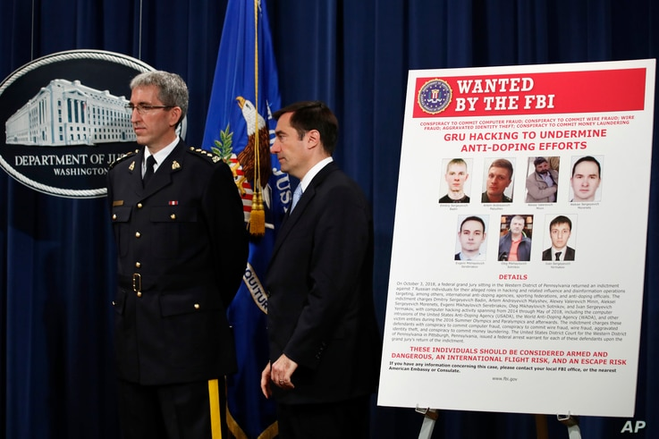 Mark Flynn, Director General for the Royal Canadian Mounted Police (L), and Assistant Attorney General for National Security John Demers, attend a news conference, Oct. 4, 2018, at the Justice Department in Washington.