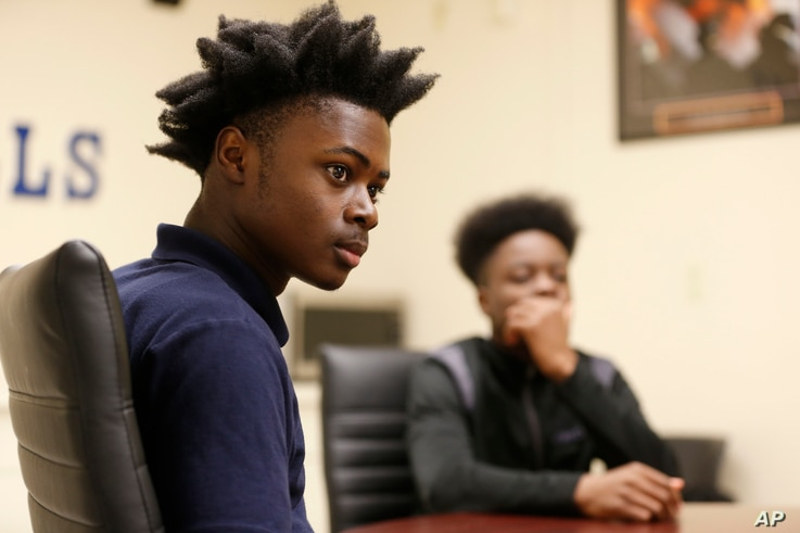 "Larry Anderson, left, and Kamal Ani-Bello, both Miami Northwestern Senior High School students who acted in the movie ""Moonlight,"" speak during an interview with The Associated Press in Miami, Feb. 27, 2017."