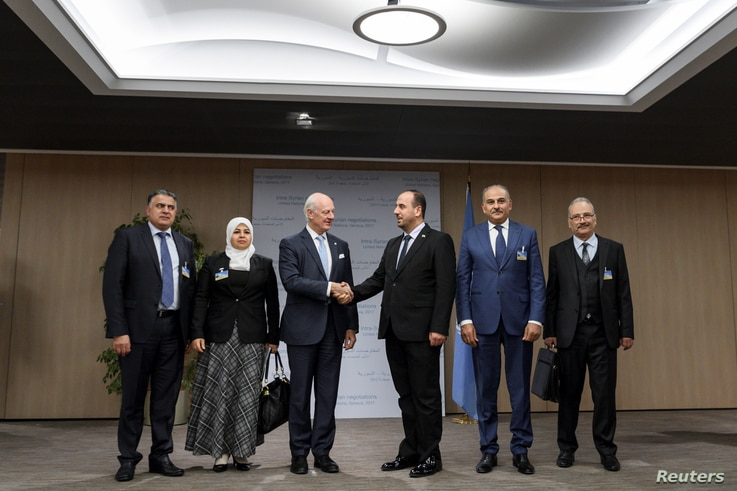 UN Special Envoy for Syria Staffan de Mistura (3rd L) shakes hands with head of the Syrian Negotiation Commission (SNC) Nasr al-Hariri (3rd R) next to opposition delegation members (from L-R) Khaled al-Mahamid, Hanadi Abu Arab, Jamal Suliman and Safw...