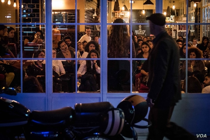 A man strolls past a storytelling event, one of many to spring up in Beirut over the past two years