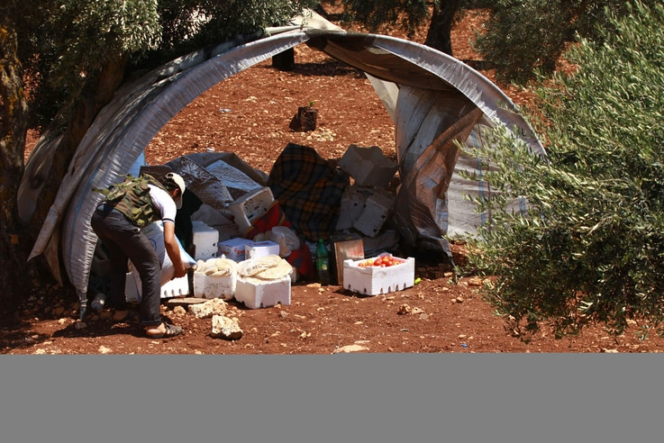 A Free Syrian Army member inspects goods that were confiscated at a checkpoint during a siege on the Kurdish city of Afrin, which is under the control of the Kurdistan Workers' Party (PKK), in the Aleppo countryside June 30, 2013. REUTERS/Hamid Khati