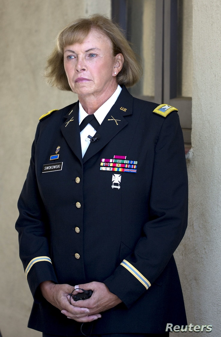 Retired Army Colonel Sheri A. Swokowski looks on during the U.S. Navy's Fleet Readiness Center Southwest's first LGBT pride event in San Diego, Calif.,  June 30, 2015. Swokowski is the highest-ranking openly transgender veteran in the country.