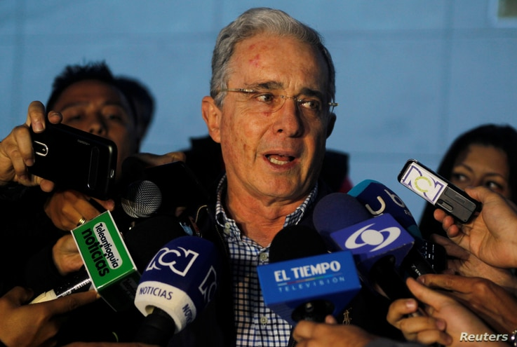 Former Colombian president Alvaro Uribe talks to the media after a meeting with Colombia President Juan Manuel Santos over a new peace deal with FARC, Nov. 12, 2016. Uribe is very much against the accord.