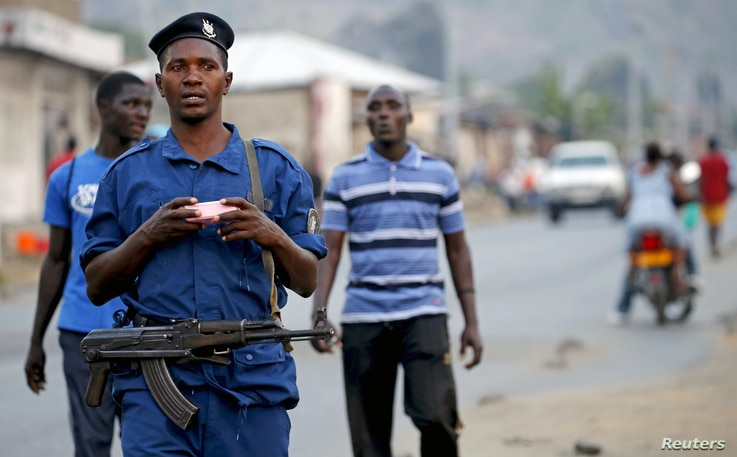 Burundi police patrol the streets of Musaga district in the capital Bujumbura after the results of the presidential elections were released, July 24, 2015.