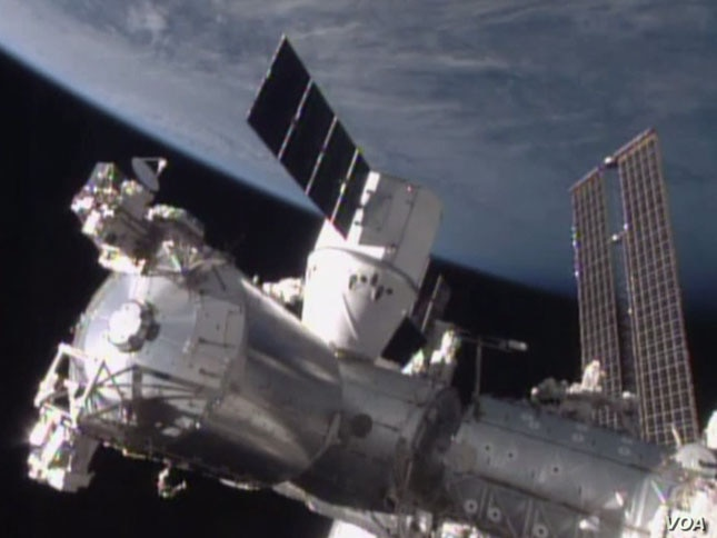 The SpaceX Dragon cargo spacecraft was berthed to the Harmony module of the International Space Station at 8:54 a.m. EST. The hatch between the newly arrived spacecraft and the Harmony module of the space station is scheduled to be opened Tuesday, bu...