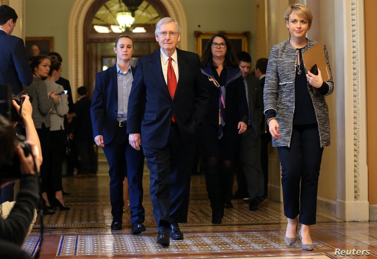 U.S. Senate Majority Leader Mitch McConnell (R-KY) leaves the Senate floor and walks back to his office after the failure of both competing Republican and Democratic proposals to end the partial government shutdown in back-to-back votes on Capitol Hi...